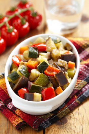 Photo for Vegetable ratatouille on wooden table - Royalty Free Image
