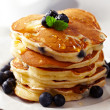 Stack of pancakes with fresh blueberry...