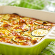 Casserole with cheese and zucchini in baking dish...