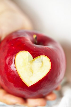 Red apple with a heart shaped cut-out