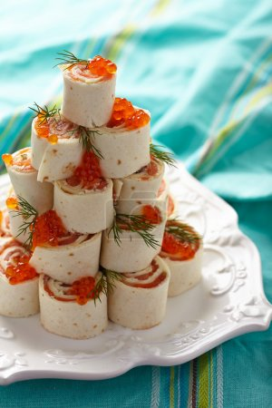 Tortilla roll up with salmon and cheese