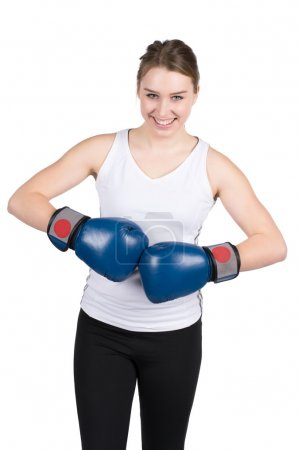 Woman holds boxing gloves against each other
