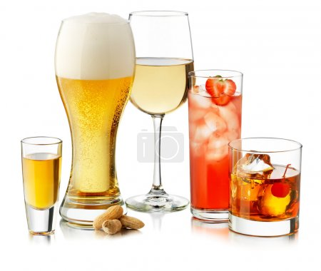 Many glasses of drinks. Juice beer and tea...