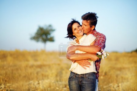 Photo for Happy couple on the field - Royalty Free Image