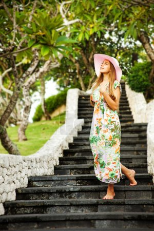 Young beautiful woman outdoors on the stairs