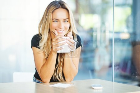 Woman drinking coffee in the morning at restaurant