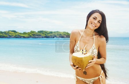 Photo for Portrait of young beautiful woman with coconut - Royalty Free Image
