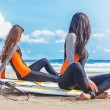 Surfer girls relaxing near the ocean...
