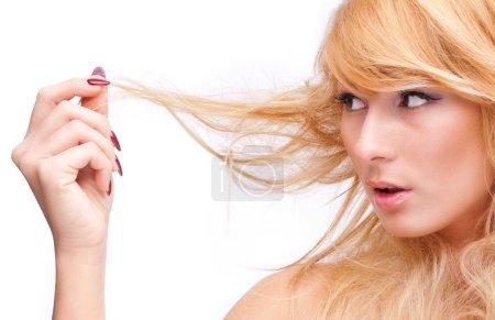 Beautiful blonde touching her hair
