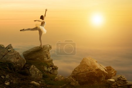 Photo for Mystic pictures, ballet dancer stands on the cliff edge - Royalty Free Image