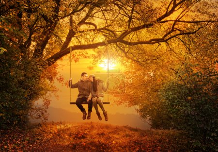 Photo for Romantic couple swing in the autumn park - Royalty Free Image