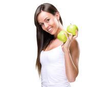 Zdravého životního stylu - krásné, přírodní žena drží dvě jablka