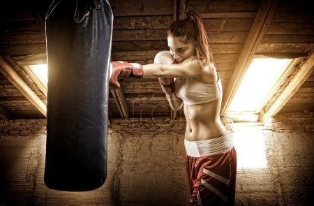 Photo for Young woman boxing workout on the attic - Royalty Free Image