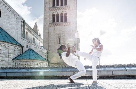 Capoeira performers doing kicking