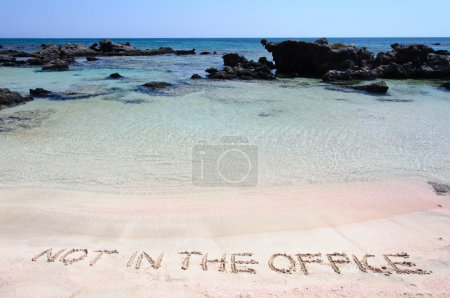 Photo for OUT OF OFFICE written on sand on a beautiful beacOUT OF OFFICE written on sand on a beautiful beach, blue waves in background, blue waves in background .Relax concept image - Royalty Free Image