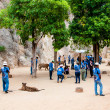 Постер, плакат: Tourists posing with tigers at the Tiger Temple on May 23 2014 in Kanchanaburi Thailand