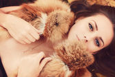 Beautiful yound woman in fur