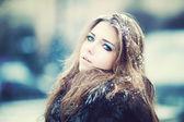 Beautiful young woman in winter