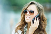 Beautiful young woman speaking on the phone