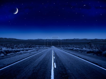 A desert road at night leading off into infinity....