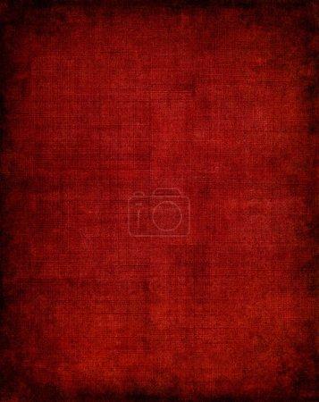 Photo pour Vieux tissu rouge vintage avec un motif d'écran et vignette sombre . - image libre de droit