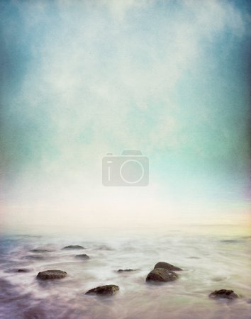 Photo for Mist and fog rising from a rocky ocean shore. Image has a vintage paper texture and displays a pleasing grain pattern - Royalty Free Image
