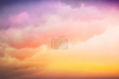 Photo pour Clouds and fog with a colorful yellow to purple-blue gradient. Image displays a pleasing paper texture visible at 100%. - image libre de droit