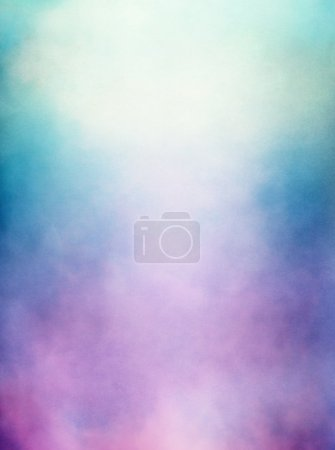 Photo for An abstraction of clouds and fog with a purple to green gradient. Image displays a distinct paper texture and grain at full size. - Royalty Free Image