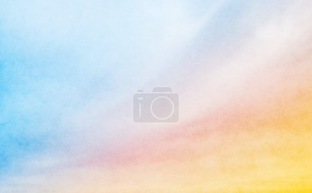 A soft cloud background with a pastel colored oran...
