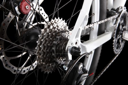 Photo for Bicycle gears, disc brake and rear derailleur. Studio shot on black background - Royalty Free Image