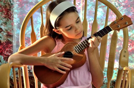 Little Hispanic Plays the Ukulele