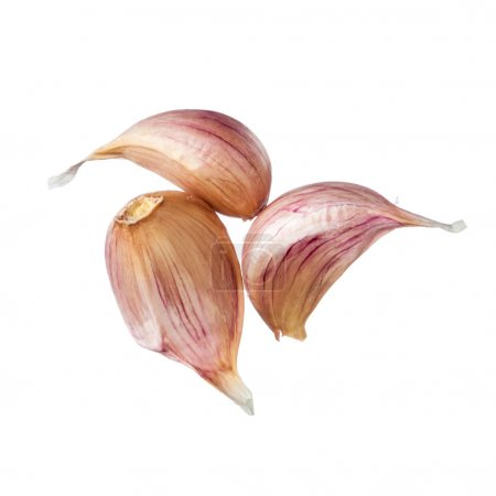 Three garlic cloves isolated on white background