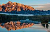 Orange Mountain Reflection in Lake Minnewanka