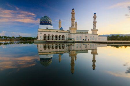Reflection of a mosque at sunrise in Sabah, Borneo, Malaysia