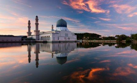 Reflection of Kota Kinabalu city mosque at sunrise in Sabah, East Malaysia, Borneo