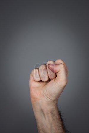 Fist pointing upwards