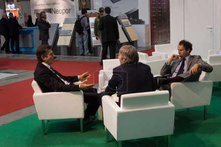 Photo for MILAN, ITALY - OCTOBER 3: Businessmen sit and talk at Made expo, international architecture and building trade show on OCTOBER 3, 2013 in Milan. - Royalty Free Image