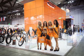 Hostesses at EICMA 2013 in Milan, Italy