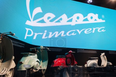 Vintage Vespa scooters at EICMA 2013 in Milan, Italy
