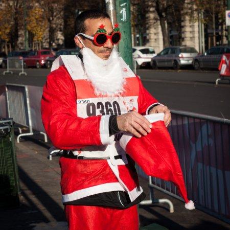 Almost 10.000 Santas take part in the Babbo Running in Milan, Italy