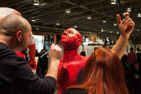 Bodybuilder during a body painting session at Milano Tattoo Convention