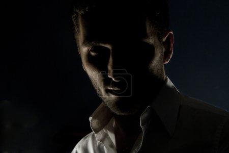Portrait of sexy man posing in studio