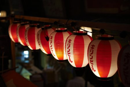 Light up traditional red and white Japanese paper balloons in Tokyo, Japan