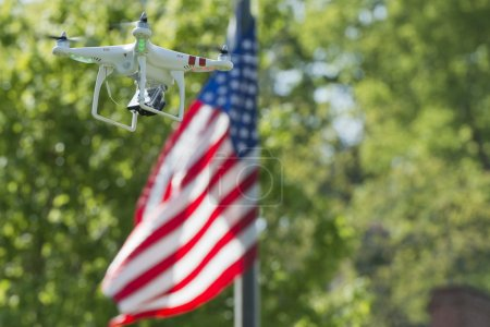 A security drone on stars and stripes USA flag