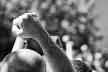 Photo for Riot hand punched in black and white - Royalty Free Image