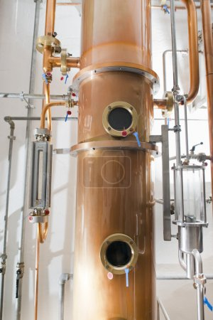 Copper still alembic inside distillery