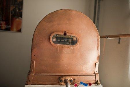 Copper still alembic inside distillery