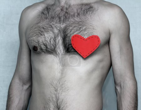 Man's chest with a red heart
