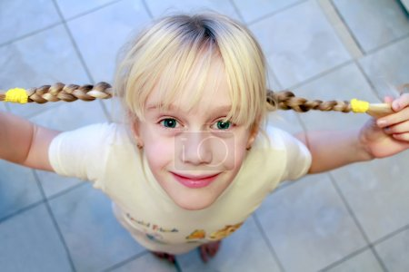 Funny girl with two braids
