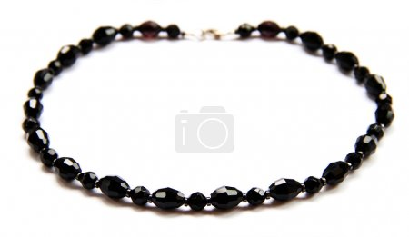 Necklace from black beads on white background